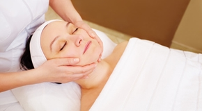 Woman taking facial treatments at beauty spa