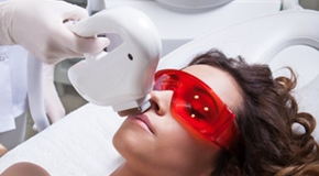 Woman getting face laser treatment, hair removal concept