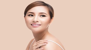 Beautiful woman cares for the skin face isolated with clipping path.