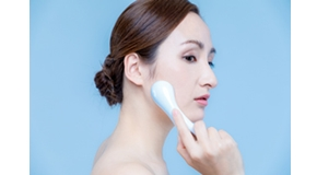 woman using handy ion introduction instrument. skincare concept.