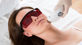 Woman Receiving Laser Epilation Treatment