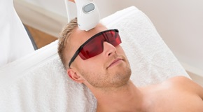 Beautician Giving Laser Epilation Treatment